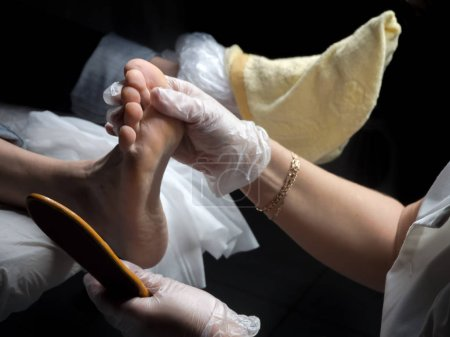 Cosmetic foot care. Process of pedicure at beauty salon.