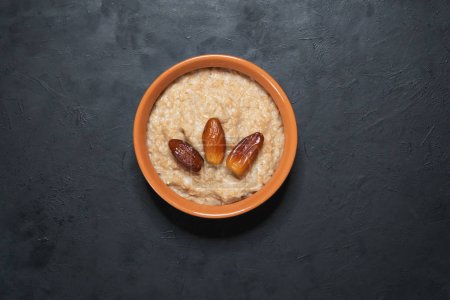Photo for Healthy eating, healthy breakfast food. Oatmeal porridge with dates - Royalty Free Image
