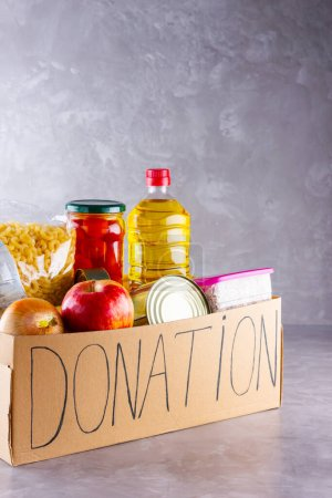 Grocery set. Donation box with food. Open cardboar...