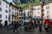 Chiavenna, Italy - 7 October, 2017: Streets of town square Piazza Rodolfo Pestalozzi with locals and tourists, Sondrio, Lombardy, Italy
