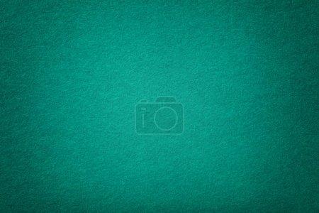 Photo pour Fond mat turquoise foncé de tissu en daim, gros plan. Texture velours de feutre de laine vert sans couture avec vignette . - image libre de droit