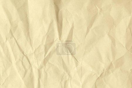 Photo pour Papier de couleur beige vieilli et ridé. Fond de couleur marron avec des kinks et effilochage . - image libre de droit