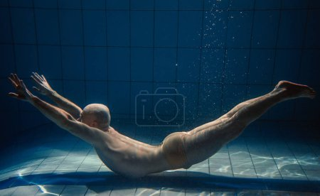 Photo for Athletic sport man underwater in the swimming pool - Royalty Free Image