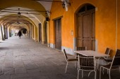 Biella, walking under the portici in the higher part of town, the Piazzo with the medieval streets