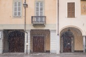 Biella, the higher part of town during the snowfall, the Piazzo with the medieval streets