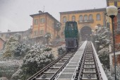 Biella, looking down to the town from the funicular station in the higher part of town during the snowfall, the Piazzo