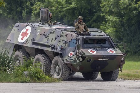 FELDKIRCHEN / GERMANY - JUNE 9, 2018: German armoured personnel carrier Fuchs, medical version drives on a road at Day of the Bundeswehr in Feldkirchen / Germany.