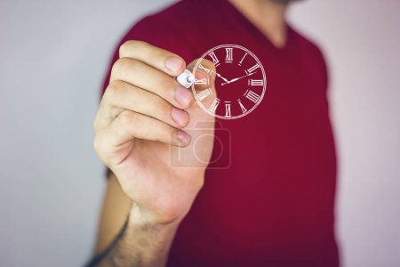 Hand holding a clock