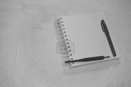 Photo for Notebook with pen and pencil. Drawing mock up. Empty sketchbook. Black background. - Royalty Free Image