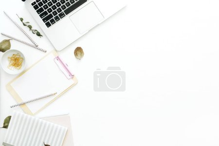 Photo for Flat lay home office desk workspace with laptop, notebook and clipboard on white background. Top view minimal mock up template. - Royalty Free Image
