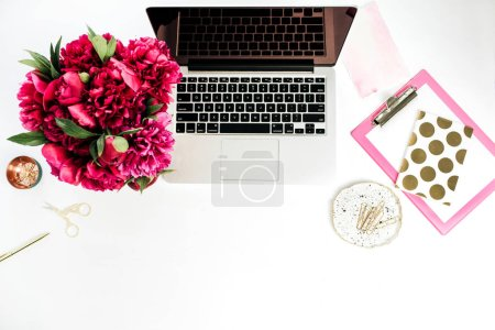 Photo for Home office desk workspace with laptop, pink peonies flowers bouquet on white background - Royalty Free Image