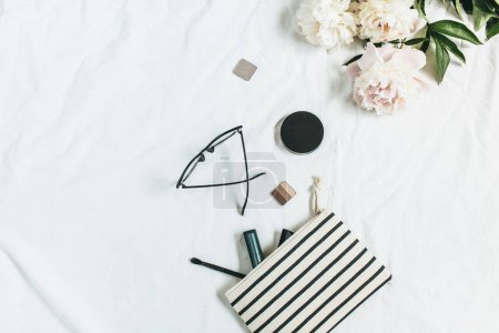 Photo for Flat lay, top view fashion background with peony flowers, glasses, cosmetics. Beauty or fashion blog concept. - Royalty Free Image