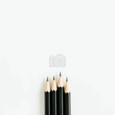 Photo for Black pencils isolated on white background. Flat lay, top view. - Royalty Free Image