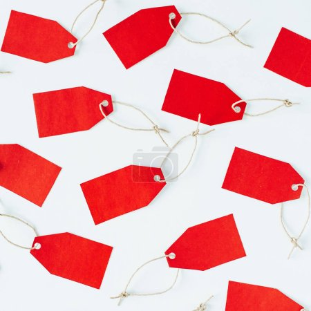 Photo for Black Friday sales discount composition. Red tags on white background. Flat lay, top view. - Royalty Free Image