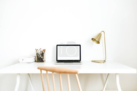 Photo for Bright home office desk workspace with mockup screen laptop. Nordic modern minimal interior design concept. Desktop table and wooden chair in white room. - Royalty Free Image