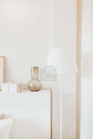 Photo for Styled interior design composition. Trendy Scandinavian living room with lamp, vase and present. - Royalty Free Image