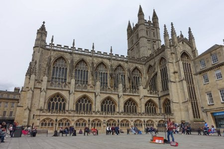 Bath, UK - May 9, 2018: Tourists and locals gather in courtyard of Bath Abbey