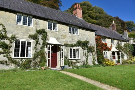 Exterior View of Traditional English Cottage Houses and Lawn Gardens