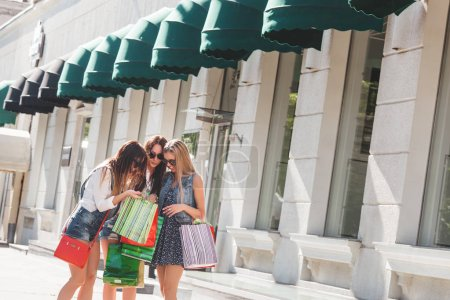 Young atractive women with shopping bags outdoors