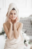 Beautiful woman in the towel relaxing after bathing