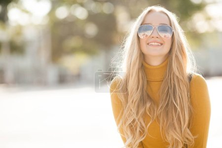 Photo for Portrait of very attractive young woman outdoor. Beautiful blond lady at urban background. Stylish female closeup portrait. - Royalty Free Image