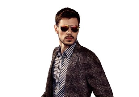 Photo for Stylish man in sunglasses and trendy jacket posing on white background - Royalty Free Image