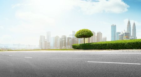 Photo for Empty asphalt road with modern city skyline . - Royalty Free Image
