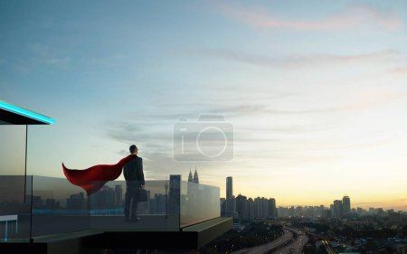 Businessman in suit and cape hero stand at open balcony looking great cityscape view and thinking business plan of the future .