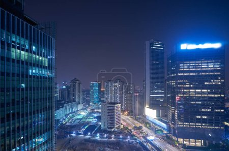 Photo for Modern office building in urban city at the night with beautiful city skyline view - Royalty Free Image