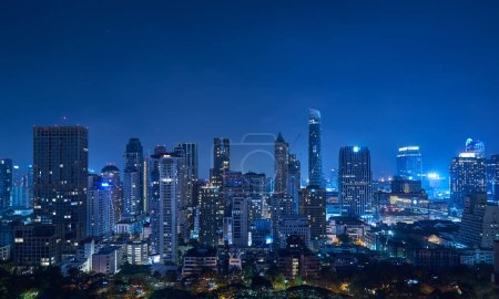 Photo for Cityscape night panorama view of Bangkok modern office business buildings and high skyscrapers in business district at Bangkok,Thailand. - Royalty Free Image