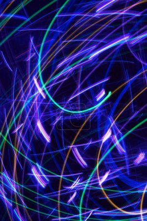 Photo for Abstract colorful glowing Impulse curved path of a orbit light background. Vertical format - Royalty Free Image