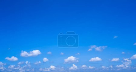 Beautiful and clean blue sky with fluffy white clouds, summer sky background.