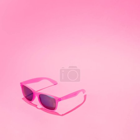 Photo for Female sunglasses on pastel pink background, Minimal summer concept - Royalty Free Image