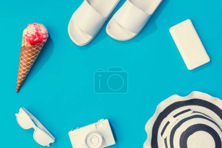 Creative layout with pink ice cream and various of summer objects on pastel blue background,  Minimal vacation concept