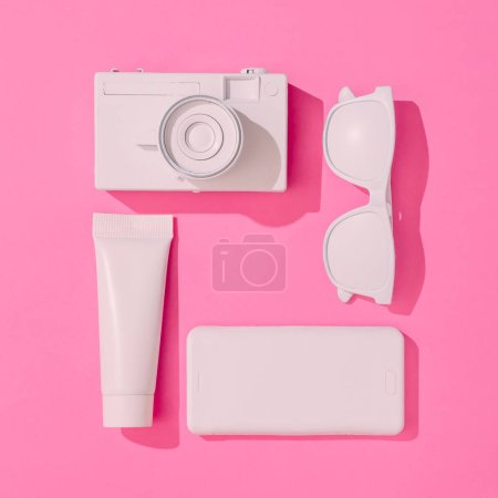 Creative neatly arranged layout with various summer objects on pastel pink background,  Minimal vacation concept