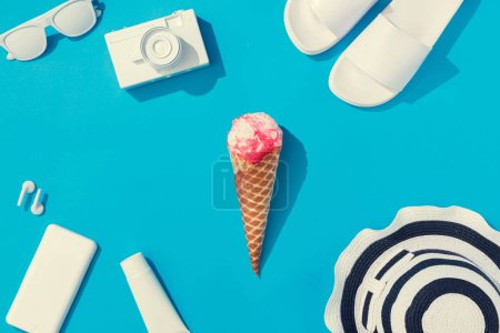 Photo for Creative layout with pink ice cream and various of summer objects on pastel blue background,  Minimal vacation concept - Royalty Free Image