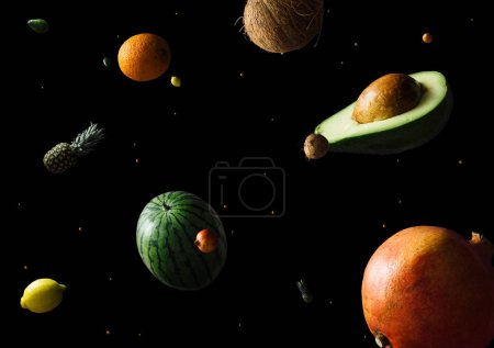 Creative abstract universe pattern with planets made of fruits on dark background, Summer  food concept