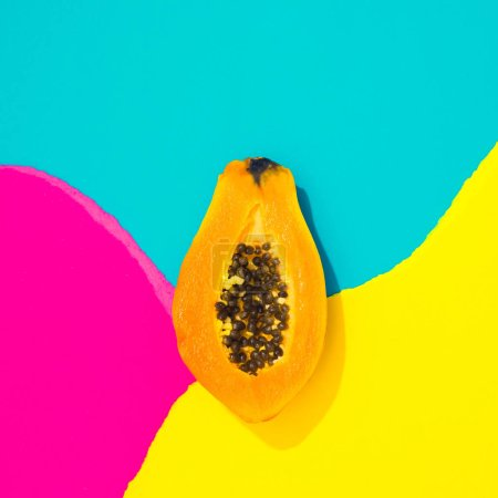 Photo for Creative tropical layout with papaya and colorful vivid papers. Abstract colors art background. Minimal summer concept. Flat lay. - Royalty Free Image