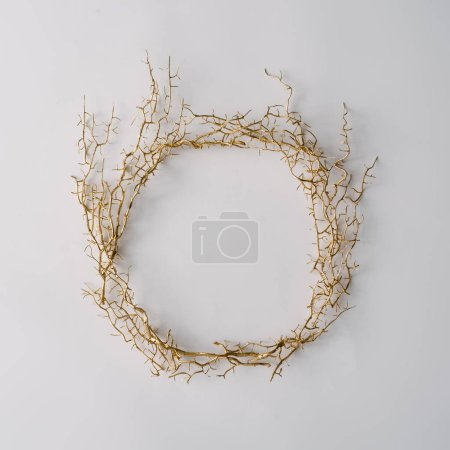 Creative layout made of branches. Minimal flat lay wreath. Autumn or winter concept.