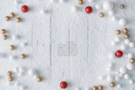 Photo for Christmas background composition with snow and ball decorations . Top view. - Royalty Free Image