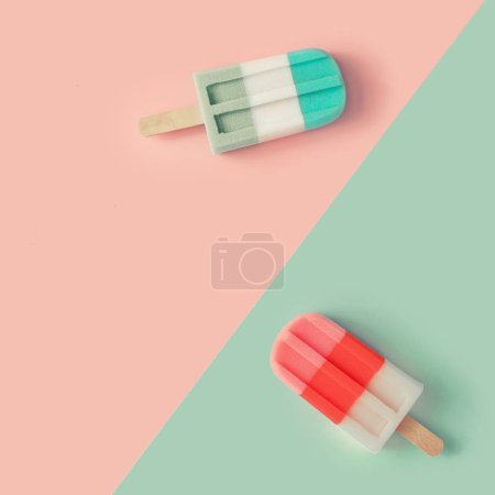 Photo for Ice cream popsicles in pastel pink and blue colors on paper duotone background. Minimal summer concept - Royalty Free Image