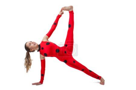 Beautiful flexible woman doing yoga poses on white...