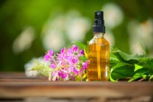 blooming Sally essential oil in a beautiful bottle on the table