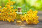tansy essential oil in a beautiful bottle on the table