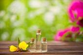 sundrops essential oil in  beautiful bottle on wooden background
