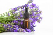 lavender essential oil in  beautiful bottle on White background
