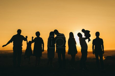 family of different generations meet the beautiful sunset time