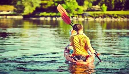 Photo for Kayaking and canoeing with family. Children on canoe. Family on kayak ride. - Royalty Free Image