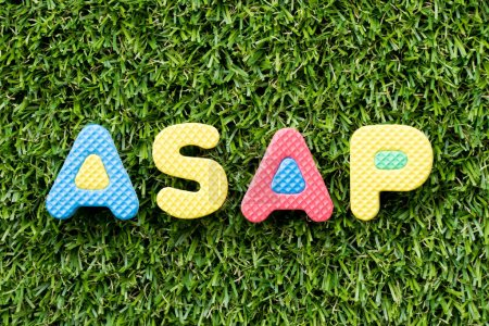 Color alphabet letter in word ASAP (Abbreviation of as soon as possible) on artificial green grass background