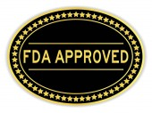 Gold and black color oval sticker with word fda approved on white background